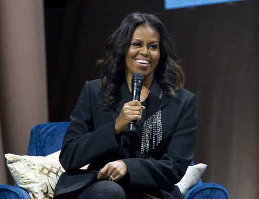 FILE - In this Nov. 17, 2018 file photo, former first lady Michelle Obama speaks to the crowd as she presents her anticipated memoir