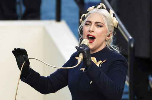 FILE - In this Wednesday, Jan. 20, 2021 file photo, Lady Gaga sings the national anthem during President-elect Joe Biden's inauguration at the U.S. Capitol in Washington. Lady Gaga's two French bulldogs, which were stolen by thieves who shot and wounded the dogwalker, were recovered unharmed Friday, Feb. 26, 2021 Los Angeles police said.(AP Photo/Saul Loeb, Pool)
