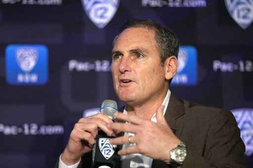FILE - In this Oct. 7, 2019, file photo, Pac-12 Commissioner Larry Scott speaks to reporters during the Pac-12 Conference women's NCAA college basketball media day in San Francisco. Scott is stepping down at the end of June 2021, ending an 11-year tenure in which the conference landed a transformational billion dollar television deal but struggled to keep up with some of its Power Five peers when it came to revenue and exposure. (AP Photo/D. Ross Cameron, File)