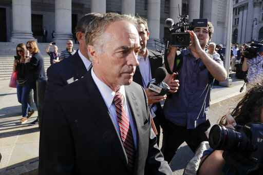 In this Oct. 1, 2019, file photo, former U.S. Rep. Chris Collins leaves federal court in New York. Prosecutors recommended Monday, Jan. 13, 2020, that Collins receive nearly five years for insider trading. U.S. District Judge Vernon Broderick is scheduled to sentence Collins on Friday. (AP Photo/Frank Franklin II, File)