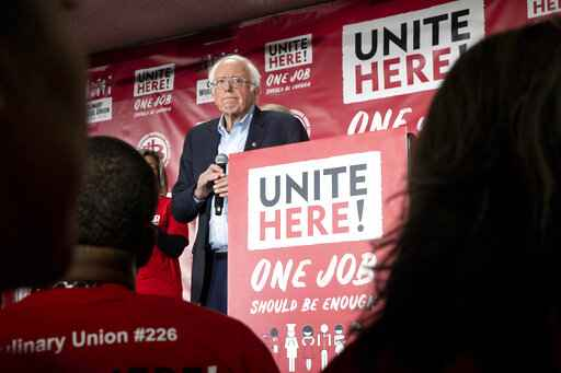 Democratic presidential candidate Sen. Bernie Sanders, I-Vt., reacts during a town hall meeting at the Culinary Workers Union Local 226 hosted by UNITE HERE, Tuesday, Dec. 10, 2019, in Las Vegas. Sanders, appearing before several hundred union workers in Las Vegas, explained his Medicare for All plan, which would switch the country to a government-run system and eliminate private health insurance. (Krystal Ramirez/Las Vegas Sun via AP)