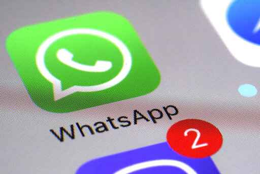 FILE - This Friday, March 10, 2017 file photo shows the WhatsApp communications app on a smartphone, in New York. A German privacy regulator banned Facebook on Tuesday May 11, 2021, from gathering data on WhatsApp users, citing an update to its privacy policy that breaches stringent European data protection rules by allowing access to a lot more information on the chat app's users. (AP Photo/Patrick Sison, File)