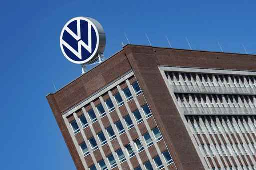 FILE - In this Monday, April 27, 2020. file photo,  The Volkswagen logo stand on the top of a VW headquarters building in Wolfsburg, Germany. Volkswagen is gradually launch the production at important plants after the corona lockdown. (Swen Pfoertner/dpa via AP)