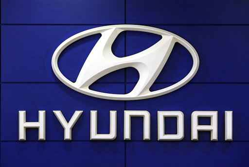 FILE - This July 26 2018 file photo shows the logo of Hyundai Motor Co. in Seoul, South Korea. Hyundai is recalling over 390,000 vehicles in the U.S. and Canada, Tuesday, May 4, 2021,  for problems that can cause engine fires. In one recall, owners are being told to park outdoors until repairs are made. That recall covers more than 203,000 Santa Fe Sport SUVs from 2013 through 2015.  (AP Photo/Ahn Young-joon, File)