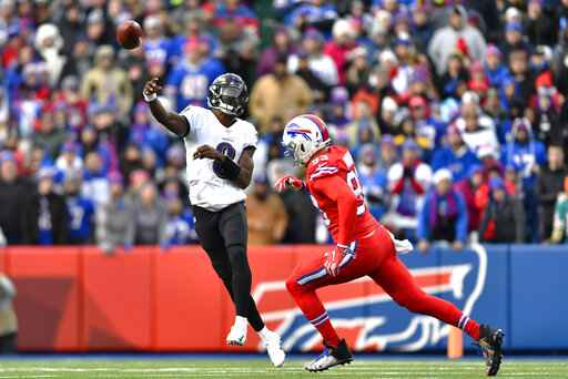 Baltimore Ravens quarterback Lamar Jackson (8) throws a pass under pressure by Buffalo Bills defensive end Trent Murphy (93) during the second half of an NFL football game in Orchard Park, N.Y., Sunday, Dec. 8, 2019. The Ravens won 24-17. (AP Photo/Adrian Kraus)