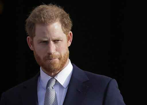 FILE - In this Thursday, Jan. 16, 2020, file photo, Britain's Prince Harry arrives in the gardens of Buckingham Palace in London. Prince Harry said Sunday, Jan. 19 that he felt