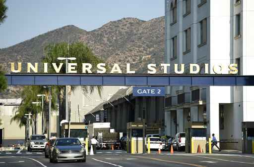 FILE - In this Aug. 23, 2016 file photo, the entrance to the Universal Studios lot is pictured in Universal City, Calif. A film built around the premise of liberal