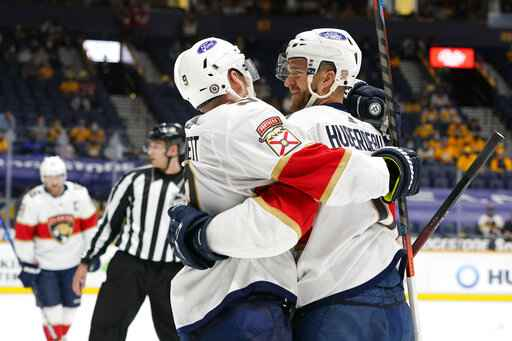 Florida Panthers left wing Jonathan Huberdeau, right, is congratulated by Sam Bennett (9) after Huberdeau scored a goal against the Nashville Predators in the third period of an NHL hockey game Tuesday, April 27, 2021, in Nashville, Tenn. (AP Photo/Mark Humphrey)