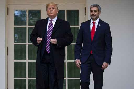 President Donald Trump poses for photos with Paraguay's President Mario Abdo Benitez at the White House, Friday, Dec. 13, 2019, in Washington. (AP Photo/ Evan Vucci)