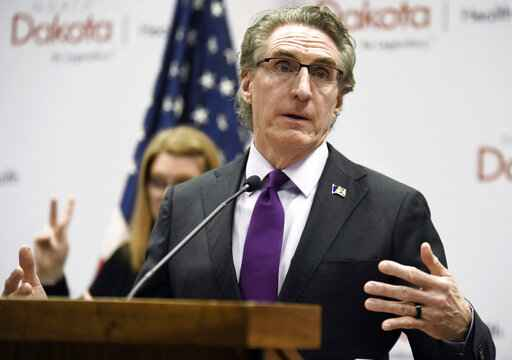 FILE - In this April 10, 2020, file photo, North Dakota Gov. Doug Burgum speaks at the state Capitol in Bismarck, N.D. Burgum will face Democratic gubernatorial candidate Shelley Lenz in the Nov. 3, general election. (Mike McCleary/The Bismarck Tribune via AP, File)