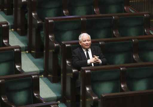 Jaroslaw Kaczynski, leader of the conservative ruling party Law and Justice, takes part in a parliamentary session in Warsaw, Poland, Friday, April 3, 2020. Uncertainty deepened in Poland on Friday over whether the country will move forward with a presidential election scheduled for May despite the coronavirus pandemic. Kaczynski had hoped to move forward with the vote despite the epidemic by having a postal election, but the head of a faction in his coalition is opposed and wants the elections postponed by two years. (AP Photo/Czarek Sokolowski)