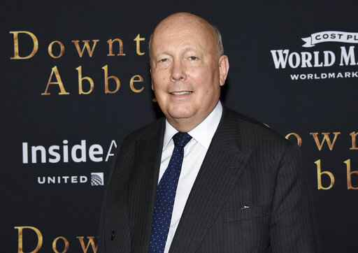 FILE - In this Sept. 16, 2019, file photo writer-producer Julian Fellowes attends the premiere of