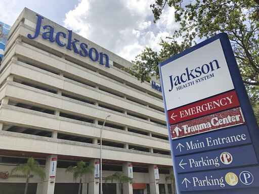 An entrance at Jackson Memorial Hospital is shown, Thursday, July 9, 2020, in Miami. Florida reported on Thursday the biggest 24-hour jump in hospitalizations, with more than 400 patients being admitted. (AP Photo/Wilfredo Lee)