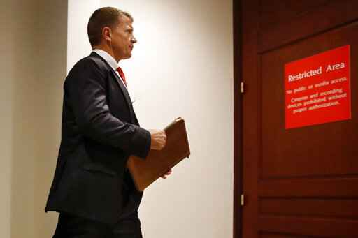 FILE - In this Nov. 30, 2017 file photo, Blackwater founder Erik Prince arrives for a closed meeting with members of the House Intelligence Committee on Capitol Hill in Washington. Prince, a major Trump donor and the founder of controversial security firm formerly known as Blackwater, traveled to Caracas last Nov. 2019, for a secret meeting with Venezuela's vice president, according to several people familiar with the visit. (AP Photo/Jacquelyn Martin, File)