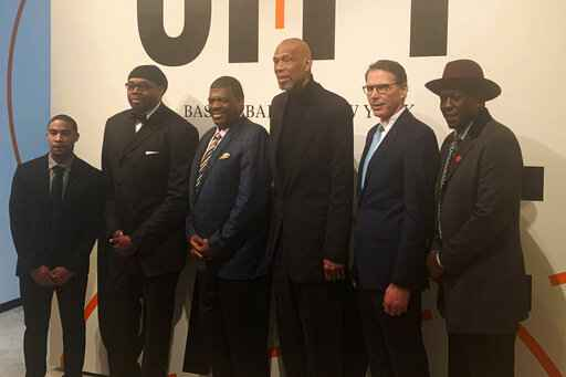 In this Feb. 11, 2020, photo, from left, New York basketball stars Andre Barrett, Sam Perkins, Bernard King, Kareem Abdul-Jabbar, Kiki VanDeWeghe and Felipe Lopez pose for a photo at the Museum of the City of New York, to celebrate the opening of an exhibit to honor the history of the game in the big apple. The exhibit has high school college and pro memorabilia including rare photos and videos of Abdul-Jabbar playing in high school. (AP Photo/Doug Feinberg)
