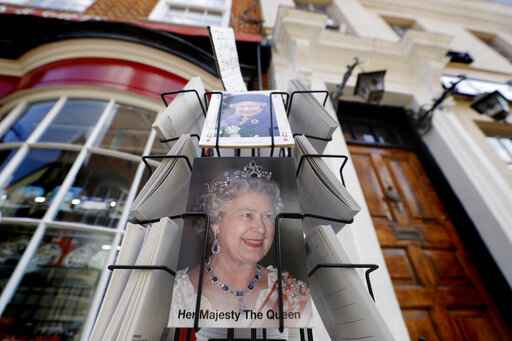 Postcards with pictures of Queen Elizabeth II for sale in Windsor, England Wednesday, April 21, 2021. Britain's Queen Elizabeth II is marking her 95th birthday in a low-key fashion at Windsor Castle, just days after the funeral of her husband Prince Philip. Some members of the royal family are expected to be with the queen on Wednesday. Her birthday falls within the two-week royal mourning period for Philip that is being observed until Friday. (AP Photo/Kirsty Wigglesworth)