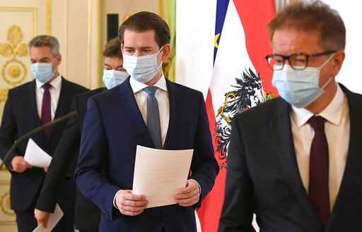 Austrian ministers, with from left: Austrian Interior Minister Karl Nehammer, Vice Chancellor Werner Kogler, Chancellor Sebastian Kurz and Minister for Social Affairs Rudolf Anschober arrive for a news conference about the coronavirus situation in Austria, in Vienna, Austria, Monday, April 6, 2020.  The COVID-19 coronavirus causes less serious symptoms for most people, but for some it causes severe illness and even death.(Helmut Foringer/Pool via AP)
