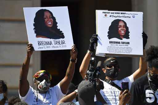 FILE - Signs are held up showing Breonna Taylor during a rally in her honor on the steps of the Kentucky State Capitol in Frankfort, Ky., Thursday, June 25, 2020. The city of Louisville will pay several million dollars to the mother of Breonna Taylor and install police reforms as part of a settlement of a lawsuit from Taylor's family, The Associated Press has learned. (AP Photo/Timothy D. Easley, File)