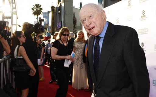 FILE - Norman Lloyd poses before a 50th anniversary screening of the film