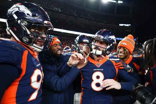 Denver Broncos kicker Brandon McManus (8) celebrates after kicking the game winning field goal against the Los Angeles Chargers during the second half of an NFL football game Sunday, Dec. 1, 2019, in Denver. (AP Photo/Jack Dempsey)