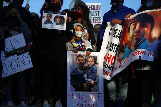 Demonstrators protest the shooting of 13-year-old Adam Toledo, Friday, April 16, 2021, in Logan Park in Chicago. (AP Photo/Shafkat Anowar)