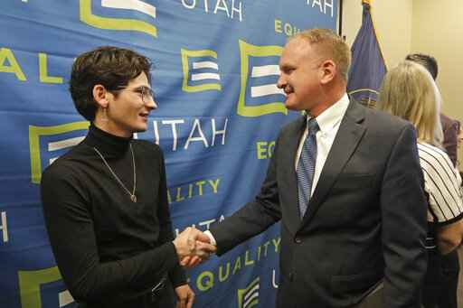 Nathan Dalley, left, shakes hands with Republican Utah Rep. Craig Hall following a news conference about the discredited practice of conversion therapy for LGBTQ children, now banned in Utah Wednesday, Jan. 22, 2020, at the Utah State Capitol, in Salt Lake City. Dalley under went so-called conversion therapy. (AP Photo/Rick Bowmer)