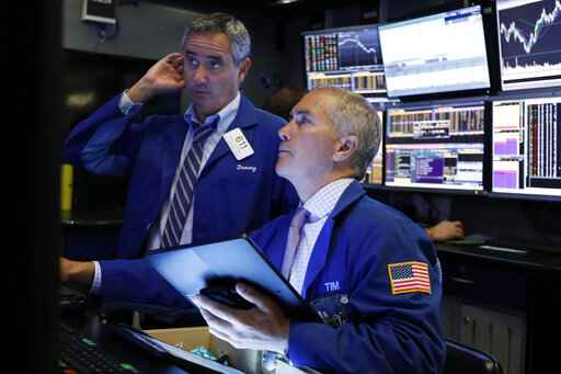 FILE - In this Oct. 2, 2019, file photo traders Daniel Trimble, left, and Timothy Nick work on the floor of the New York Stock Exchange. The U.S. stock market opens at 9:30 a.m. EDT on Wednesday, Oct. 9. (AP Photo/Richard Drew, File)