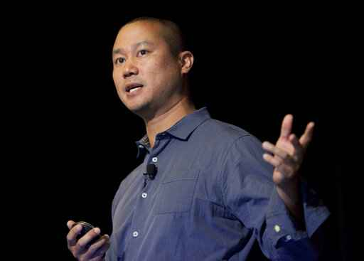 FILE - In this Sept. 30, 2013, file photo, Tony Hsieh speaks during a Grand Rapids Economic Club luncheon in Grand Rapids, Mich. Hsieh, retired CEO of Las Vegas-based online shoe retailer Zappos.com, has died. Hsieh was with family when he died Friday, Nov. 27, 2020, according to a statement from DTP Companies, which he founded. Downtown Partnership spokesperson Megan Fazio says Hsieh passed away in Connecticut, KLAS-TV reported. Hsieh recently retired from Zappos after 20 years leading the company. He worked to revitalize the Las Vegas area. (Cory Morse/The Grand Rapids Press via AP, File)
