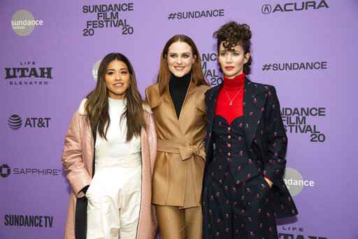 FILE - Actors, from left, Gina Rodriguez and Evan Rachel Wood pose with writer-director Miranda July at the premiere of
