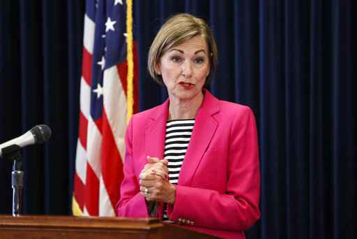 File-This June 18, 2020, file photo shows Iowa Gov. Kim Reynolds updating the state's response to the coronavirus outbreak during a news conference at the Statehouse, in Des Moines, Iowa. Reynolds on Monday, June 29, 2020, signed into law a bill that requires women to wait 24 hours before getting an abortion, trying again to institute a restriction similar to one struck down two years ago by the Iowa Supreme Court.  (AP Photo/Charlie Neibergall, Pool, File)