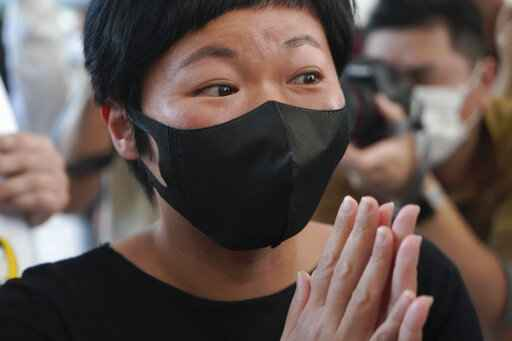 Hong Kong journalist Choy Yuk-ling, also known as Bao Choy, arrives a court in Hong Kong Thursday, April 22, 2021.� Choy appeared in court on Thursday for verdict on charges of making false statements while obtaining information from a vehicle database. Choy, a producer at public broadcaster Radio Television Hong Kong, was arrested in Nov 2020. She was involved in the production of an investigative documentary into the behavior of Hong Kong police during 2019 anti-government protests, after the force was accused of not intervening during a violent clash between protesters and a mob of men in a subway station. (AP Photo/Kin Cheung)