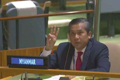 In this image taken from video by UNTV, Myanmar Ambassador to the United Nations Kyaw Moe Tun flashes the three-fingered salute, a gesture of defiance done by anti-coup protesters in Myanmar, at the end of his speech before the U.N. General Assembly at the United Nations Friday, Feb. 27 , 2021. Myanmar's U.N. ambassador strongly opposed the military coup in his country and appealed for the