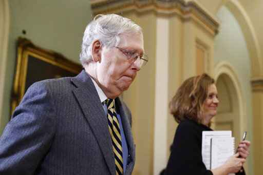 Senate Majority Leader Mitch McConnell of Ky., departs the chamber on Capitol Hill in Washington, Monday, Jan. 27, 2020, after the impeachment trial of President Donald Trump on charges of abuse of power and obstruction of Congress ended for the day. (AP Photo/Patrick Semansky)