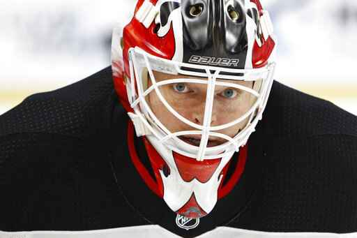 FILE - In this Oct. 9, 2017, file photo, New Jersey Devils goalie Corey Schneider (35) skates prior to the first period of an NHL hockey game against the Buffalo Sabres in Buffalo, N.Y. NHL players are concerned the league will announce a