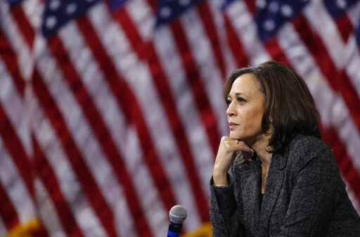 FILE - In this Oct. 2, 2019, file photo, then -Democratic presidential candidate Sen. Kamala Harris, D-Calif., listens during a gun safety forum in Las Vegas. Democratic presidential candidate former Vice President Joe Biden has chosen  Harris as his running mate. (AP Photo/John Locher, File)