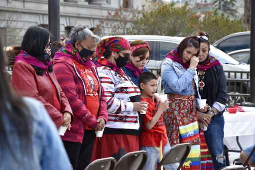 Family members of missing and murdered indigenous women in Montana gather in front of the state Capitol in Helena, Mont., Wednesday, May 5, 2021. They received colorful shawls in a traditional Native American ceremony called