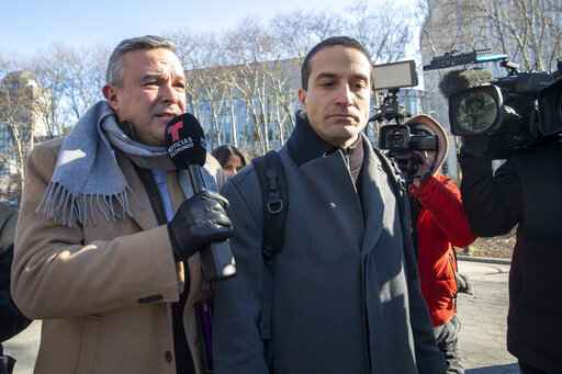 Cesar De Castro, center, attorney for Genaro Garcia Luna, Mexico's former top security official, is surrounded by reporters as he leaves Federal court in Brooklyn, Tuesday, Jan. 21, 2020, in New York. (AP Photo/Mary Altaffer)