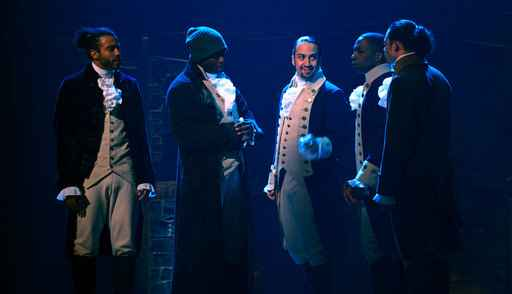 In this image released by Disney Plus, from left, Daveed Diggs, Okieriete Onaodowan, Lin-Manuel Miranda, Leslie Odom Jr. and Anthony Ramos appear in a filmed version of the original Broadway production of