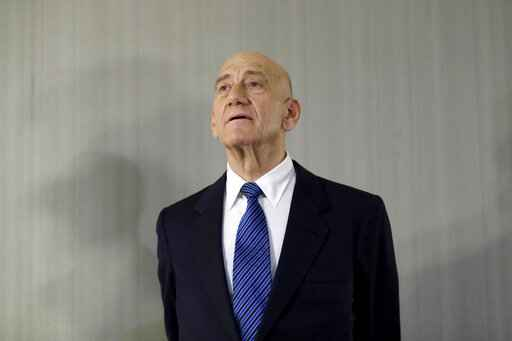 FILE - In this Feb. 11, 2020 file photo, former Israeli Prime Minister Ehud Olmert takes questions from reporters after a news conference in New York. Israeli Prime Minister Benjamin Netanyahu is threatening to sue his predecessor, Olmert, for defamation. Netanyahu is reportedly seeking over $300,000 in damages if Olmert does not apologize for saying the Israeli leader's family suffers from mental illness. (AP Photo/Seth Wenig, File)