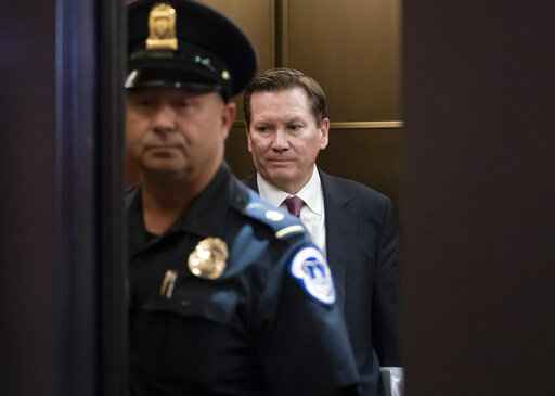 FILE- In this Oct. 4, 2019 file photo, Michael Atkinson, the inspector general of the intelligence community, steps into an elevator as he leaves a secure area in the Capitol after a day of questions about the whistleblower complaint that exposed a July phone call the president had with Ukrainian President Volodymyr Zelenskiy in which Trump pressed for an investigation of Democratic political rival Joe Biden and his family, at the Capitol in Washington . The ousted inspector general of the intelligence community says he is