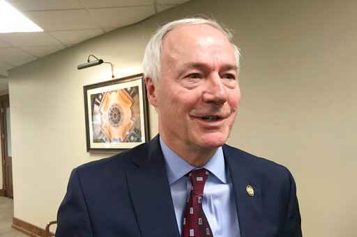 Arkansas Gov. Asa Hutchinson speaks to reporters in Little Rock Ark. A federal appeals court panel in Washington has upheld a lower court's decision that blocked the Trump administration's work requirements for M