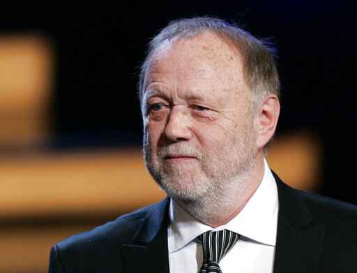 FILE - In this Friday, Jan. 19, 2007 file photo German movie producer Joseph Vilsmaier attends the awarding ceremony of the Bavarian Movie Award at the Prinzregententheater in Munich, Germany. German filmmaker Joseph Vilsmaier, whose striking portrayal of the Battle of Stalingrad brought home the horrors of war to a new generation, has died. His agent confirmed Wednesday that Vilsmaier 'died peacefully at his home' in Bavaria on Tuesday at the age of 81. (AP Photo/Christof Stache, file)