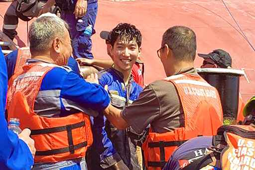 Four crew members of capsized cargo ship rescued