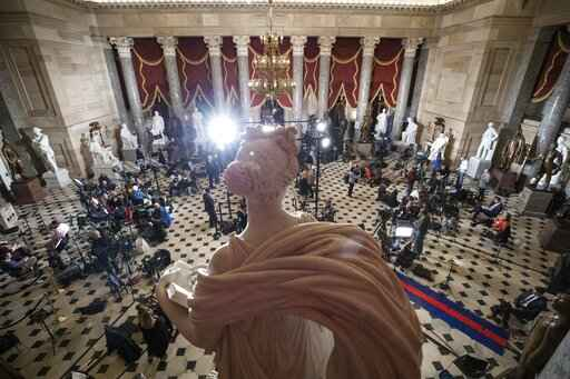 Statuary Hall, near the House floor, is set up for news media for the State of the Union address by President Donald Trump, on Capitol Hill, Tuesday, Feb. 4, 2020 in Washington. (AP Photo/Alex Brandon)