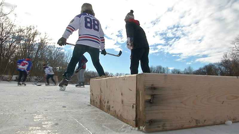 Kids play hockey on the Erie Canal
