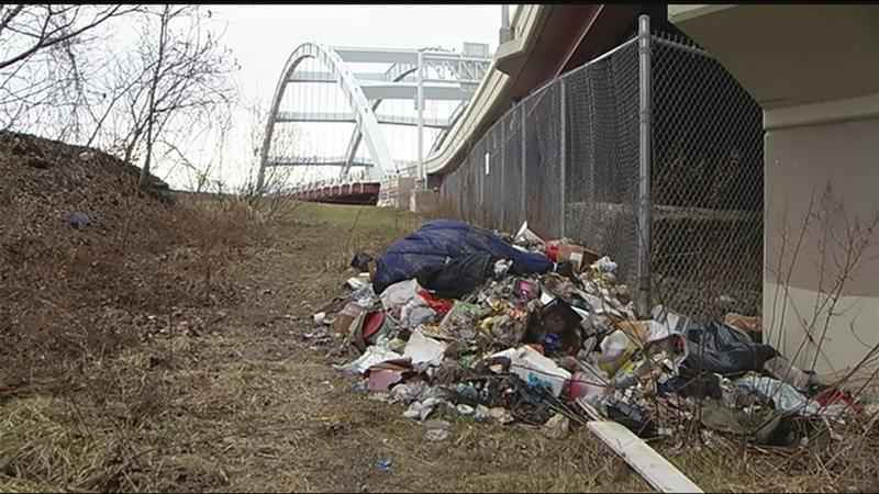Trash pile near 490 in Rochester sparks questions