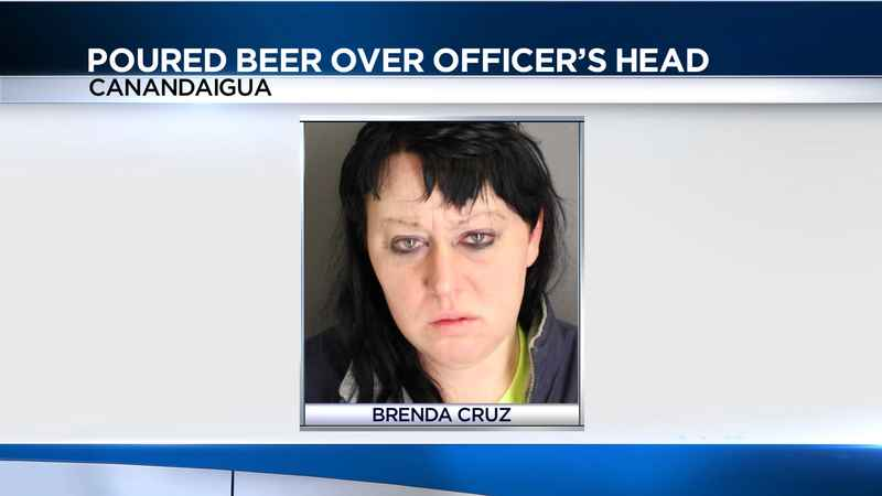 Police: Canandaigua Woman poured can of beer on an officer