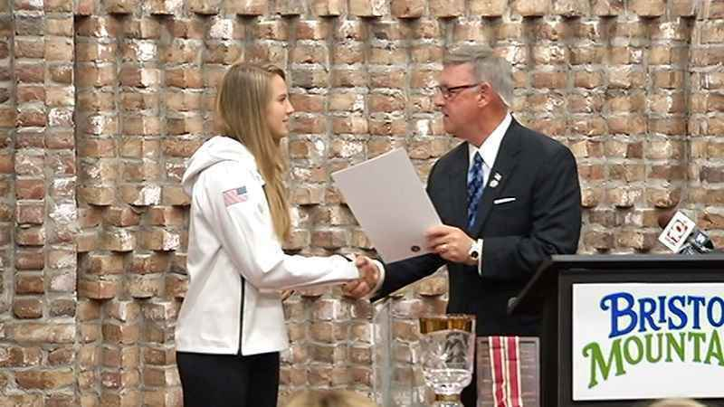 Morgan Schild receiving an award from State Senator Rich Funke in 2017.