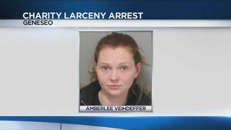 Warsaw woman accused of stealing from charity