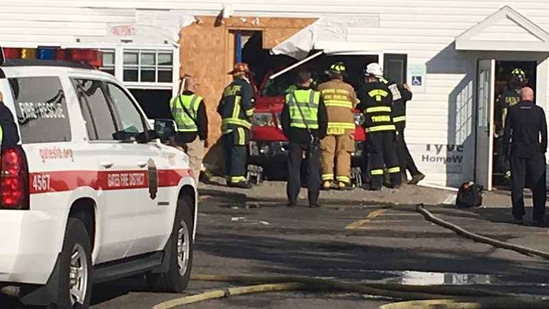 Truck slams into Gates apartment building